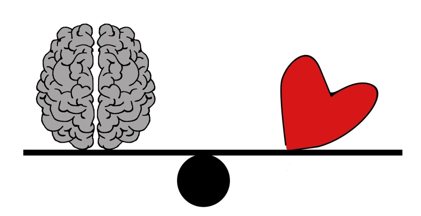 Brain and Heart on Scale Showing Equal Importance